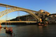 rabelo boat over douro river and the luis I bridge