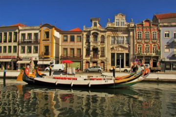 Art Nouveau buildings in aveiro and the moliceiros boats